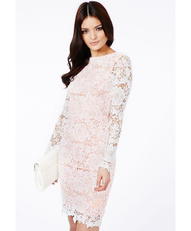 This long sleeved black lace dress that contains floral patterns throughout its outer surface is done in a European style. The front section of the dress is done in a dark black style, while the sleeves and the backside of the dress are left open.