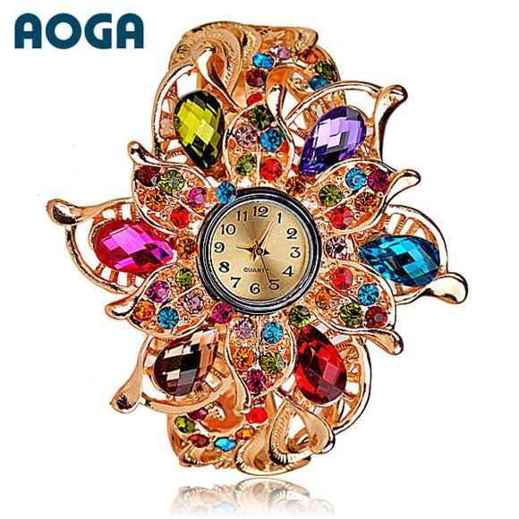 Часы-брошь наручные многоцветные. фото