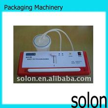 Portable vacuum packaging machine/vacuum sealing machine in low price for 2014 family used