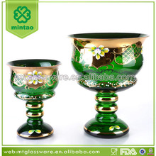 antique tall green and golden glass flower vase