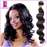 Wholesale Price and Unprocessed Brazilian Remy Wavy Hair Tape Extensions
