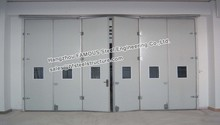 sectional folding door used in steel garage and workshop