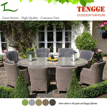 TG15-0087 Oval outdoor wicker table with brighton dining armchairs