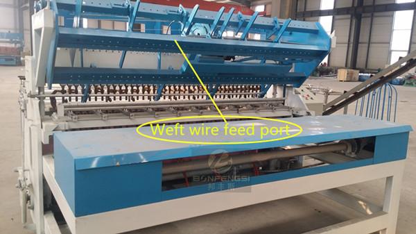 Fence panels welding machine weft wire feed port.jpg