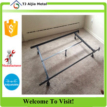 metal double side bed frame with a headboard attachment