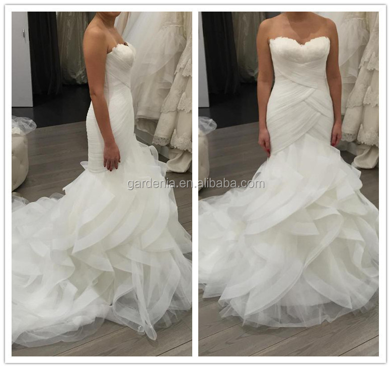 Brand name reality show ivory color ruffles bridal gown for Wedding dress with feathers on bottom