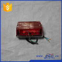 SCL-2014070085 AX100 Motorcycle Parts Plastic Front Cover of Rear Light
