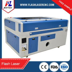 low price autofocus co2 laser cutter for plywood/plastic/fabric with red dot