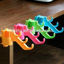 Ganchos y clips de plástico con multifunciones para almacenamiento en el hogar