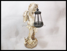 Custom factory price home decor resin baby angel with lantern statue for sale