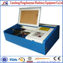 CO2 Laser rubber stamp making machine/engraving machine with corellaser/international after-sale service