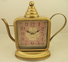 Antique gold iron table clock in teapot shaped for decorative