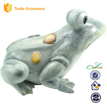 spring and summer garden decoration sitting frog
