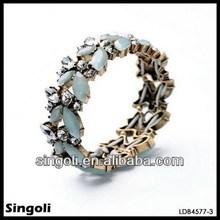 Yiwu imitation jewellery Bobo style crystalline two tiers seablue epoxy fresh paved resin crystal bead hollow 22k gold bangle