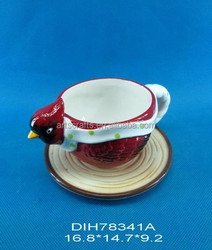 Red bird shaped ceramic cup and saucer set