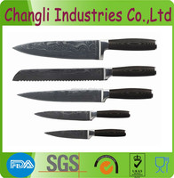 VG-10 damascus steel kitchen knife with patterns on blade