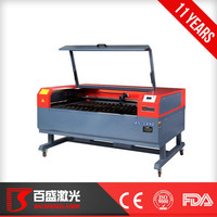 2015 newest laser engraving cutting machines with rotary high speed co2 laser machines with step motor and exhaust fan factory