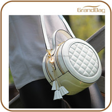 China Supplier Enamelled Real Leather Mini Small CD Album Lady Bag Circle Glossy Leather Sling HandBag for Women