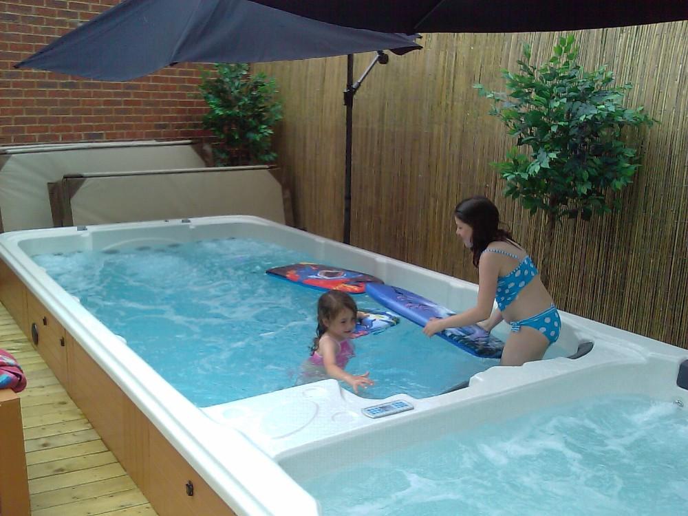 Acrylic balboa rectangular above ground outdoor swim spa for Spa swimming pool