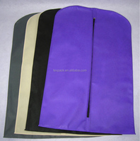 Colorful non-woven plastic dust cover with metal eyelet at bottom for T-shirt