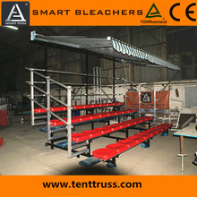 cheap metal mobile bleachers seating with striped sunshade and durable handrail for sale, custom design and elegant appearance