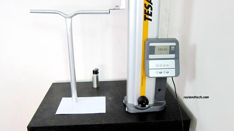Inspecting scooter bar.jpg