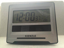Digital LCD alarm clock with solar power panel