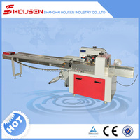 Automatic lollipop filling and wrapping machine