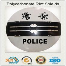 Police round anti riot shield