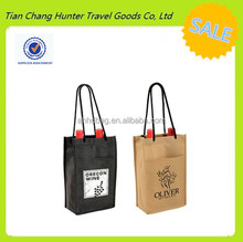 Non woven double wine bottle bag with nylon string cord handle threaded through metal eyelets and slip front pocket