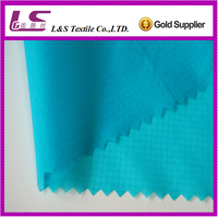 15D 440T textile fabric nylon ripstop taffeta semi dull waterproof raincoat fabric with silicone coated