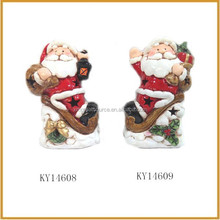outdoor ceramic sitting santa claus with gift decorative