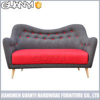 three seats gary and red color sofa bed