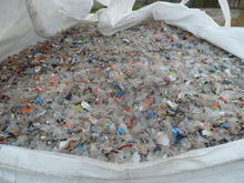 Unwashed clear PET bottle flakes