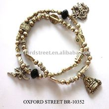 multi antiqued charm bracelet with metallic looking