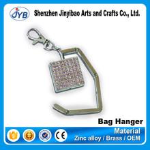 Wholesale cheap nice bag holder metal square shape folding purse hook for wedding