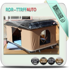 Collapseable roof top tent / fishing rod carrier carried by roof tent / Ski carried by roof tent