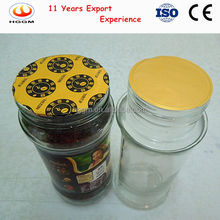 Induction seal liner for glass vessel with liquid or solid