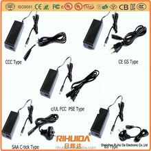Switching power supply, power adapter with grounded American plug