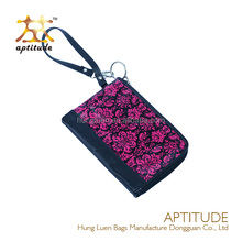 2015 Small Floral Coated Canvas Wristlet bag