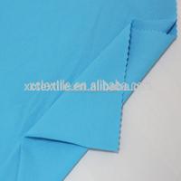 47% PBT 53% polyester elastic China wholesale uv swimwear fabric