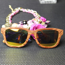 Custom wooden sunglasses with polarised lenses and bamboo case PRC