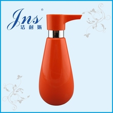 Orange fancy liquid soap dispenser with dispenser pump