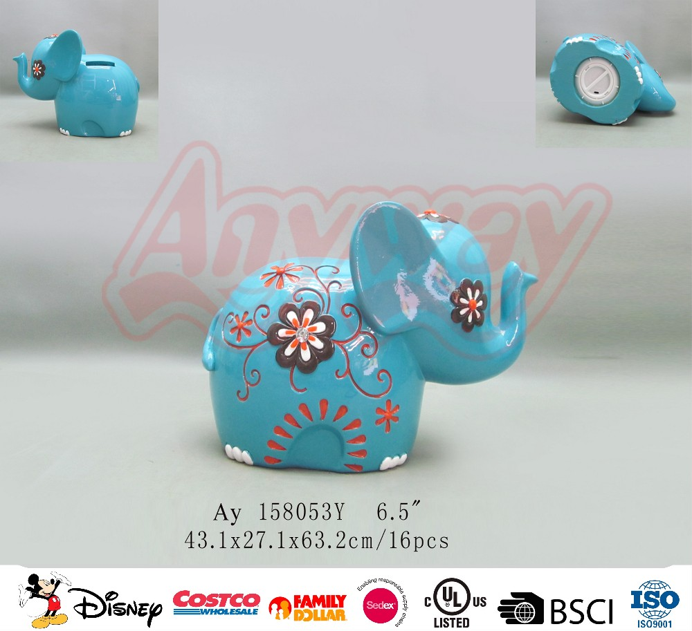 Hand painting blue elephant shape piggy bank