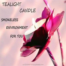 A heart shaped candle placed in a picture of a tobacco free tealight wax wholesale and a creative romantic birthday package