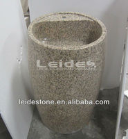 Tiger skin yellow granite pedestal with wash basin