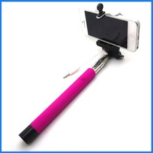 Hot selling extendable wired selfie stick with cable round stick portable self-pod monopod for cell phone