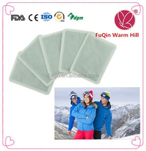 Adhesive non-woven hot patches for sports in winter