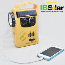 AM FM solar powered portable radio with flashlight and hand crank dynamo function can charge mobile phone