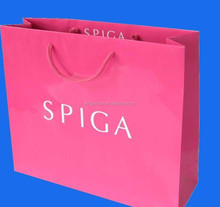 folded gift shopping bag pink color
